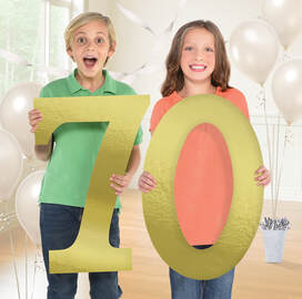 Two Kids Holding the Number 70